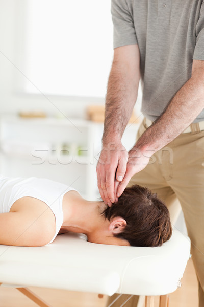 Guy massaging a radiant woman's neck in a room Stock photo © wavebreak_media