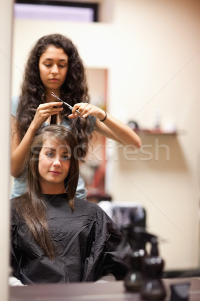 Portrait of a woman having a haircut while looking at the camera Stock photo © wavebreak_media