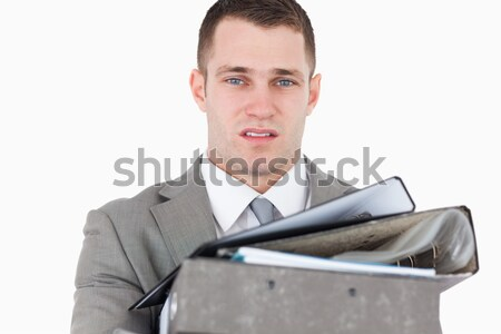 Overwhelmed young businessman against a white background Stock photo © wavebreak_media