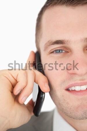 Közelkép fiatal üzletember készít telefonbeszélgetés fehér Stock fotó © wavebreak_media