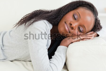 Close up of young woman lying on the couch with eyes closed Stock photo © wavebreak_media