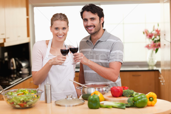 Couple drinking a glass of red wine in their kitchen Stock photo © wavebreak_media