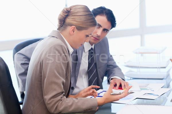 Business people looking at statistics in a meeting room Stock photo © wavebreak_media
