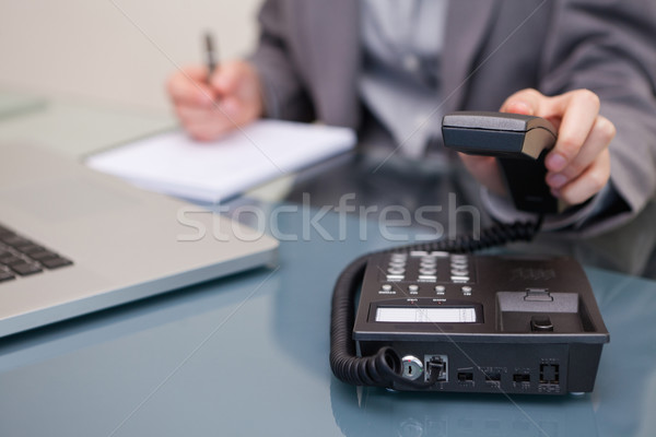 Telephone being hung up by young businesswoman Stock photo © wavebreak_media
