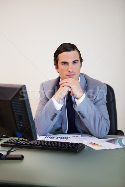 Stock photo: Businessman in thoughts sitting behind his desk