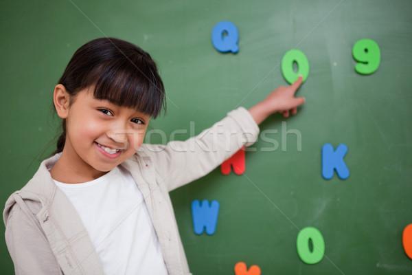 öğrenci işaret mektup tahta kız gülümseme Stok fotoğraf © wavebreak_media
