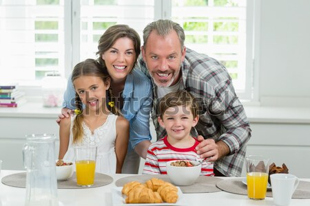Happy young family standing in the kitchen together Stock photo © wavebreak_media