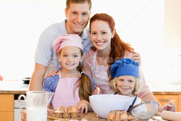 Family together with baking ingredients in the kitchen Stock photo © wavebreak_media