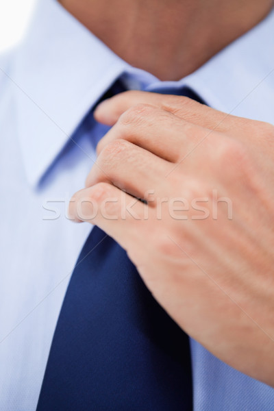 Close up of a businessman fixing his tie against a white background Stock photo © wavebreak_media