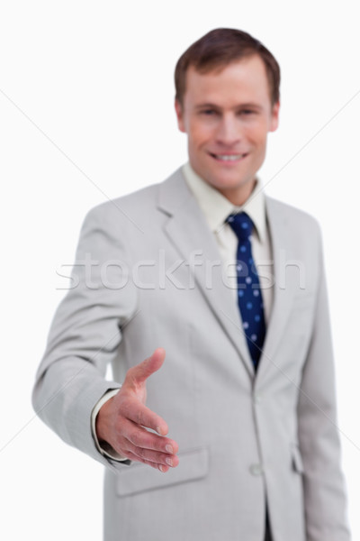 Hand being offered by smiling businessman against a white background Stock photo © wavebreak_media