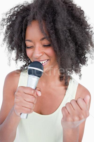 Cantando karaoke micrófono blanco diversión Foto stock © wavebreak_media
