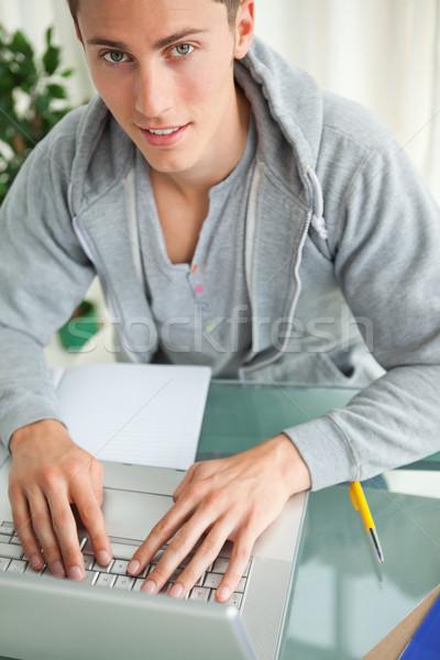Portré diák gépel netbook házi feladat dolgozik Stock fotó © wavebreak_media
