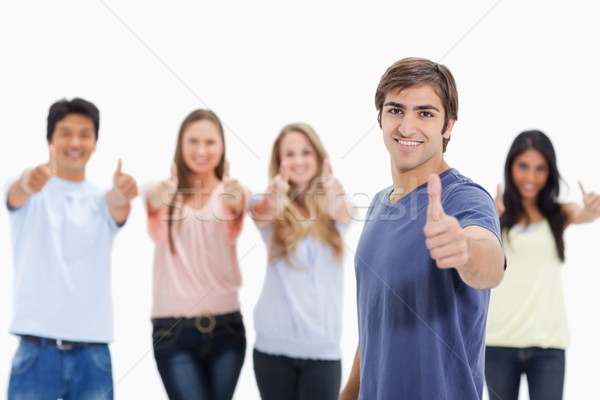 People smiling and approving with one of them in foreground against white background Stock photo © wavebreak_media