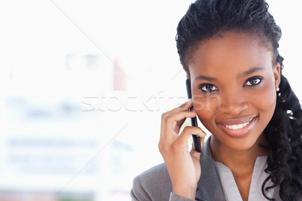 Lächelnd Geschäftsfrau schauen vor sprechen Telefon Stock foto © wavebreak_media