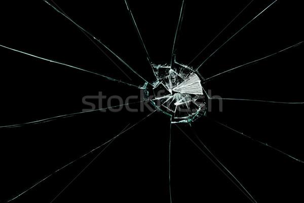 Broken squared window against a black background Stock photo © wavebreak_media