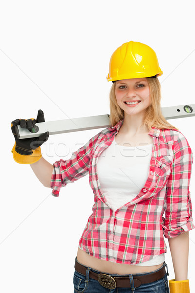 Cheerful woman holding a spirit level Stock photo © wavebreak_media