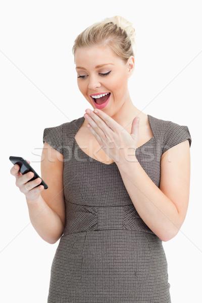 Woman receive a texting against white background Stock photo © wavebreak_media