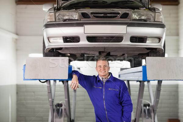 Sorridente mecânico abaixo carro garagem feliz Foto stock © wavebreak_media