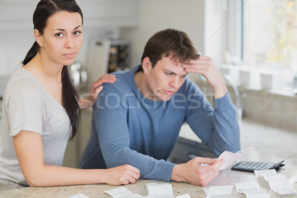 Two people in the kitchen calculating finances with calculator Stock photo © wavebreak_media