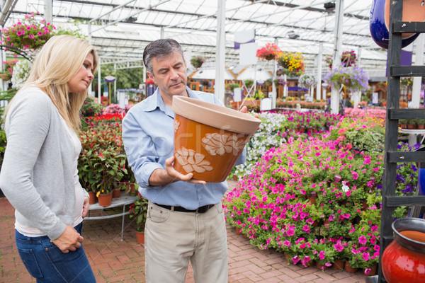 Couple deciding on flower pot in garden center Stock photo © wavebreak_media