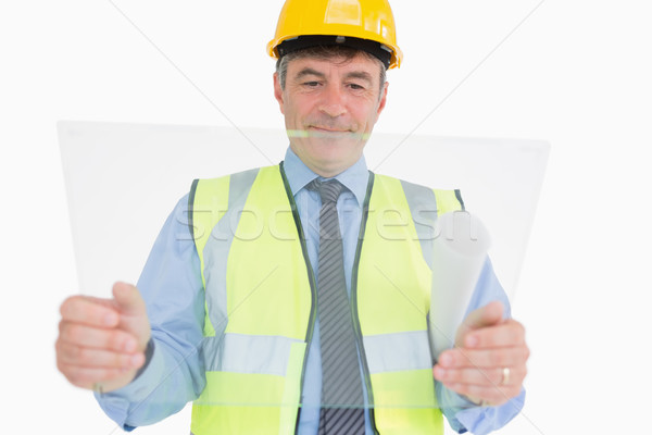 Architect holding a pane and smiling Stock photo © wavebreak_media