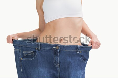 Midsection of female wearing old pants after losing weight Stock photo © wavebreak_media