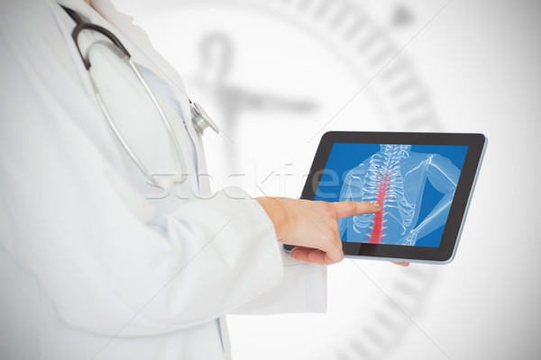 Doctor showing her tablet with red spin Stock photo © wavebreak_media