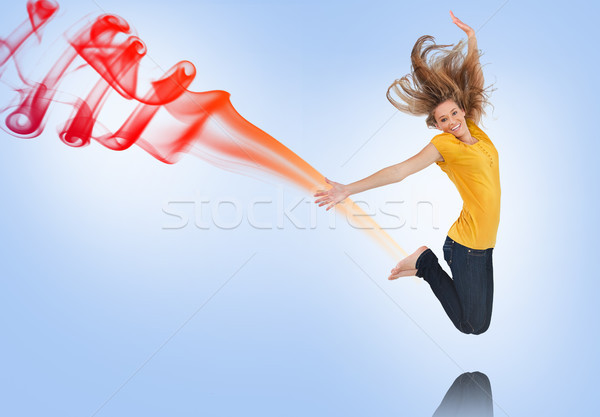 Pretty young woman jumping for joy with smoke trail Stock photo © wavebreak_media