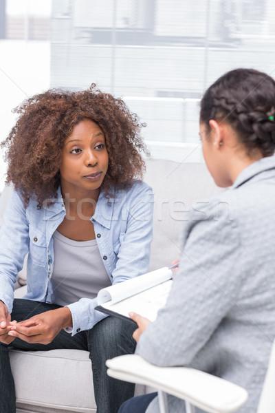 Therapist taking notes Stock photo © wavebreak_media
