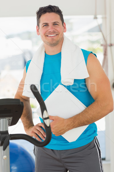 Portrait of a smiling trainer with clipboard in gym Stock photo © wavebreak_media