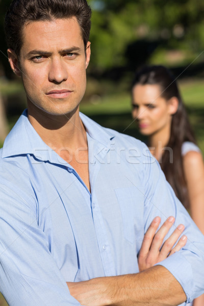 Man with blurred woman in background outdoors Stock photo © wavebreak_media