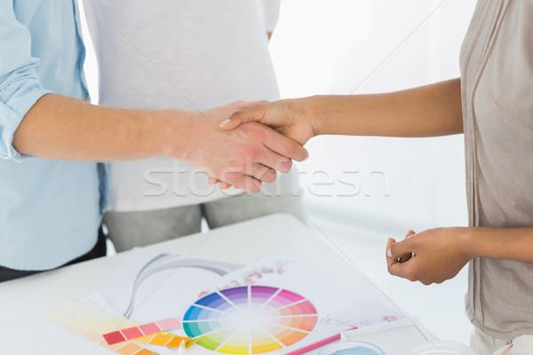 Interior designer shaking hands with customer Stock photo © wavebreak_media