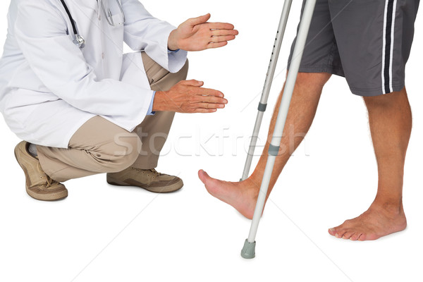 Low section of a doctor with senior man using walker Stock photo © wavebreak_media