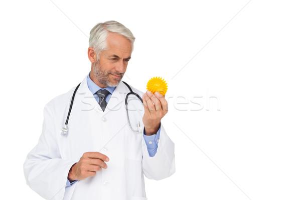 концентрированный мужской доктор глядя подчеркнуть мяча белый Сток-фото © wavebreak_media