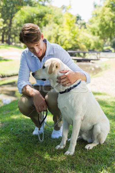 Handsome man with his labrador in the park Stock photo © wavebreak_media
