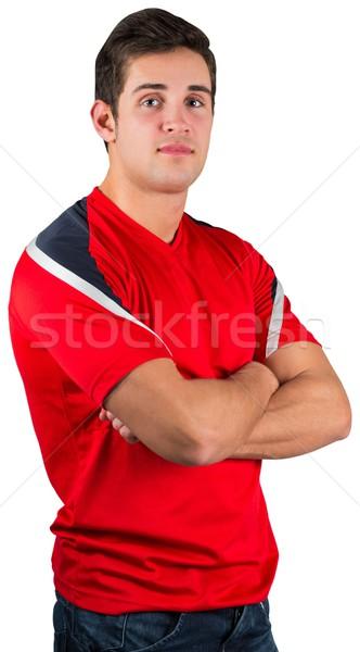 Handsome football fan in red jersey Stock photo © wavebreak_media