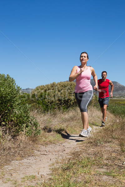 Active couple jogging on country terrain Stock photo © wavebreak_media