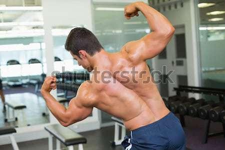 Gömleksiz kas adam poz spor salonu yandan görünüş Stok fotoğraf © wavebreak_media