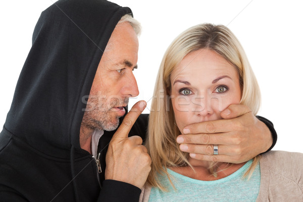 Close up of theft covering womans mouth Stock photo © wavebreak_media