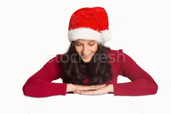 Gülümseyen aşağı bakıyor beyaz kırmızı kadın Noel Stok fotoğraf © wavebreak_media