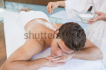 Man receiving treatment at spa center Stock photo © wavebreak_media