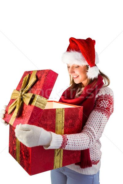 Jonge vrouw stijlvol warme kleding opening geschenk witte Stockfoto © wavebreak_media