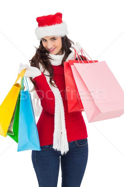 Smiling brunette in winter wear holding shopping bags Stock photo © wavebreak_media