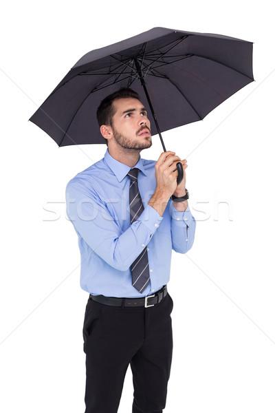 Endişeli işadamı şemsiye beyaz iş takım elbise Stok fotoğraf © wavebreak_media