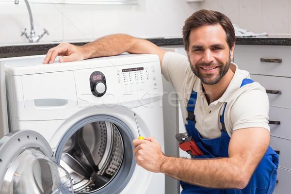 Handyman fixing a washing machine Stock photo © wavebreak_media