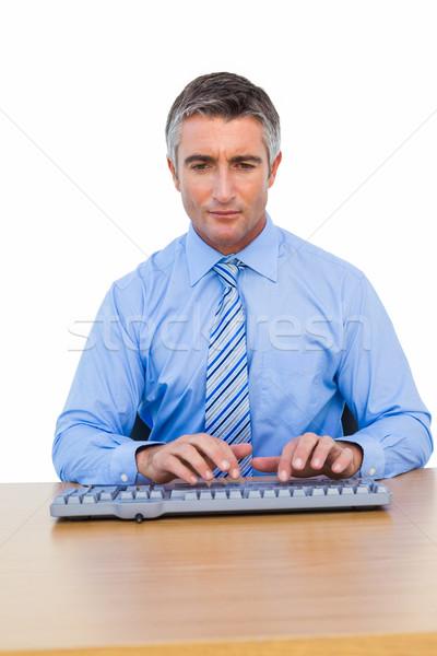 Odaklı işadamı yazarak klavye beyaz iş Stok fotoğraf © wavebreak_media