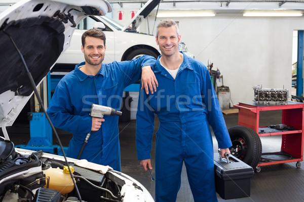 Squadra meccanica riparazione garage uomo Foto d'archivio © wavebreak_media