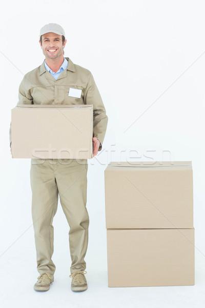 Feliz mensajero caja de cartón retrato Foto stock © wavebreak_media