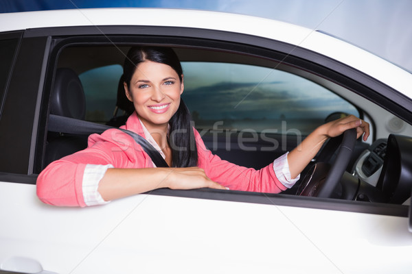 Smiling customer sitting at the wheel of a car for sale Stock photo © wavebreak_media