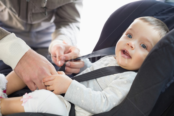 Parents securing baby in the car seat Stock photo © wavebreak_media